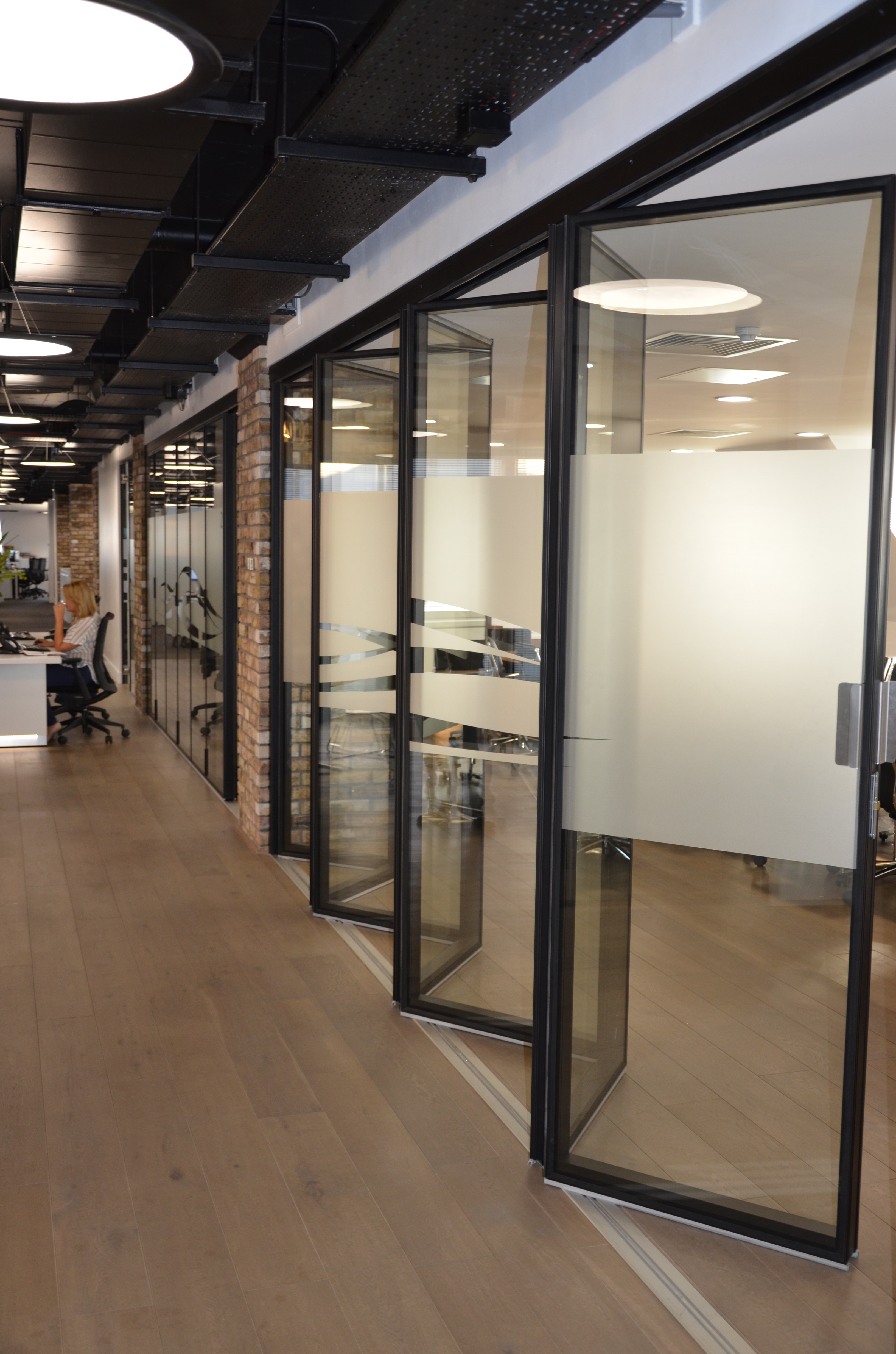 London wall launches new acoustic folding glass wall system for Folding glass wall
