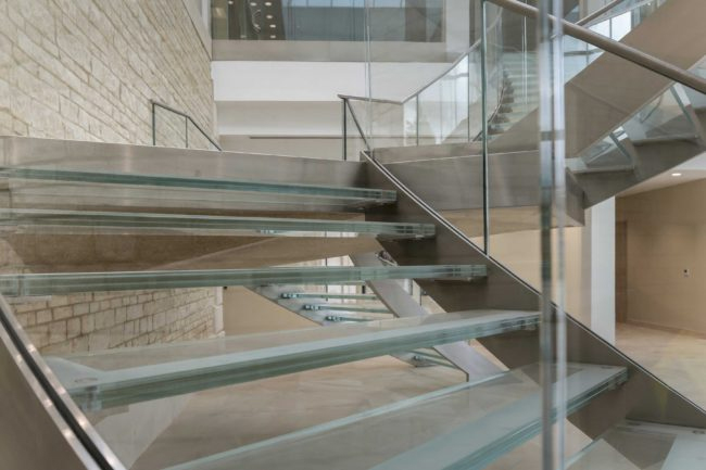 Impressive steel and glass feature staircase for home