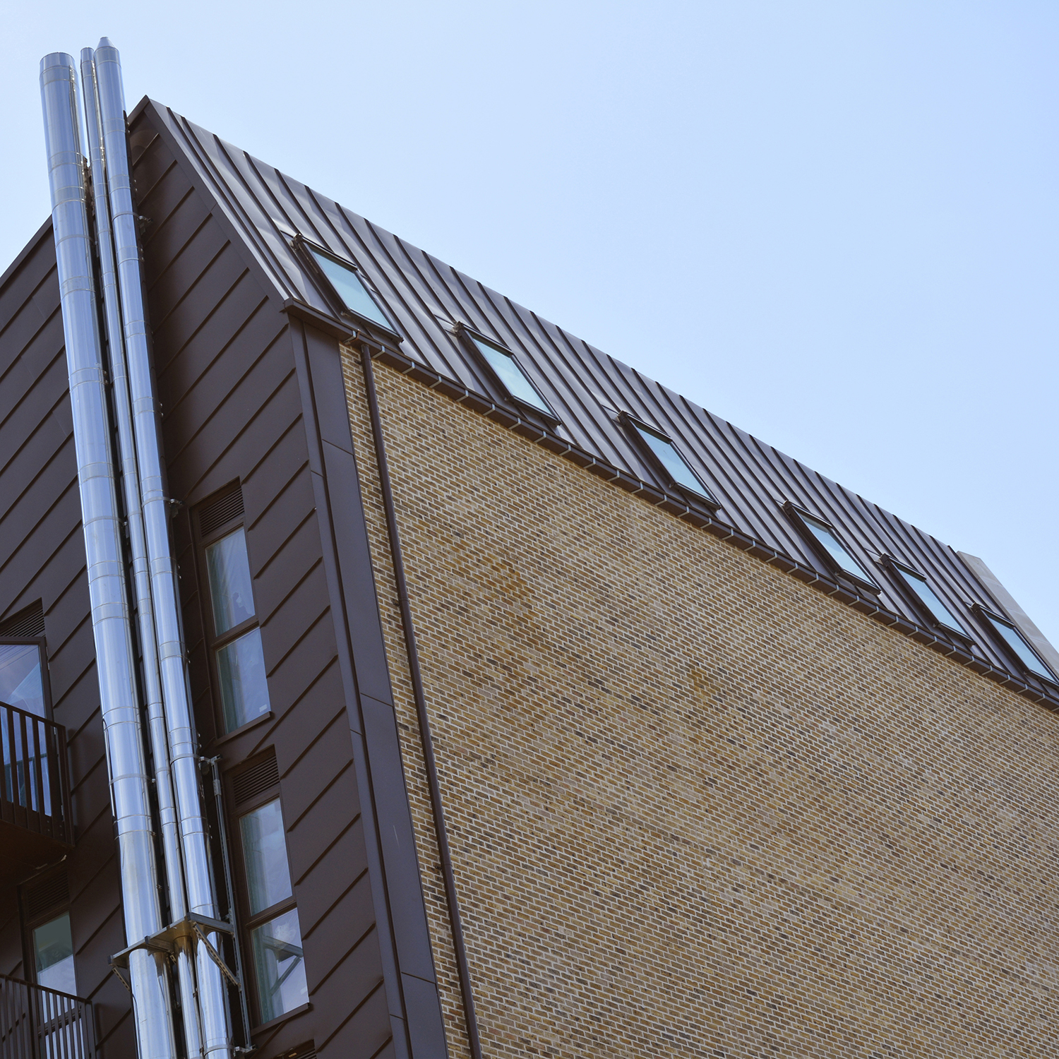4. The facades employ both vertical and diagonally laid zinc