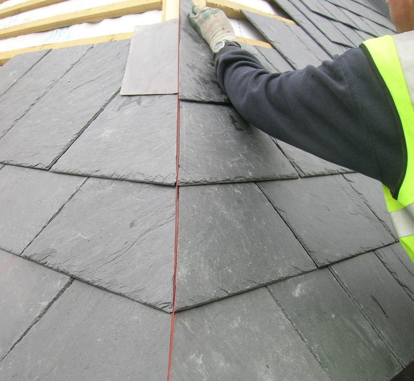 The roofer lays the thickest slates on the lowest pitches and thinnest on upper pitches