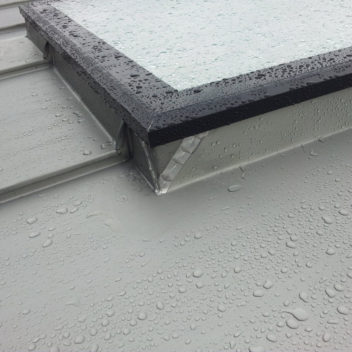 100mm upstand shown at the foot of a rooflight