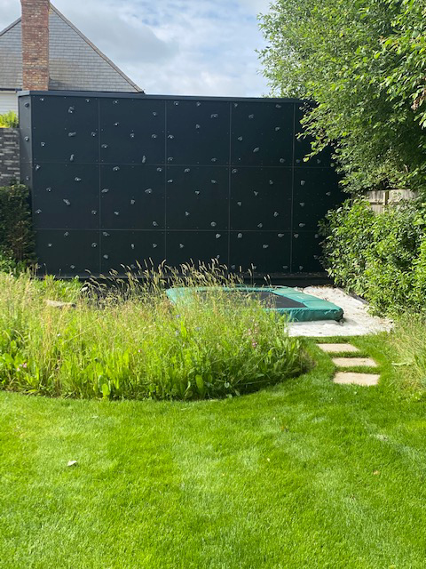 climbAwall design makes a fun addition to large family garden