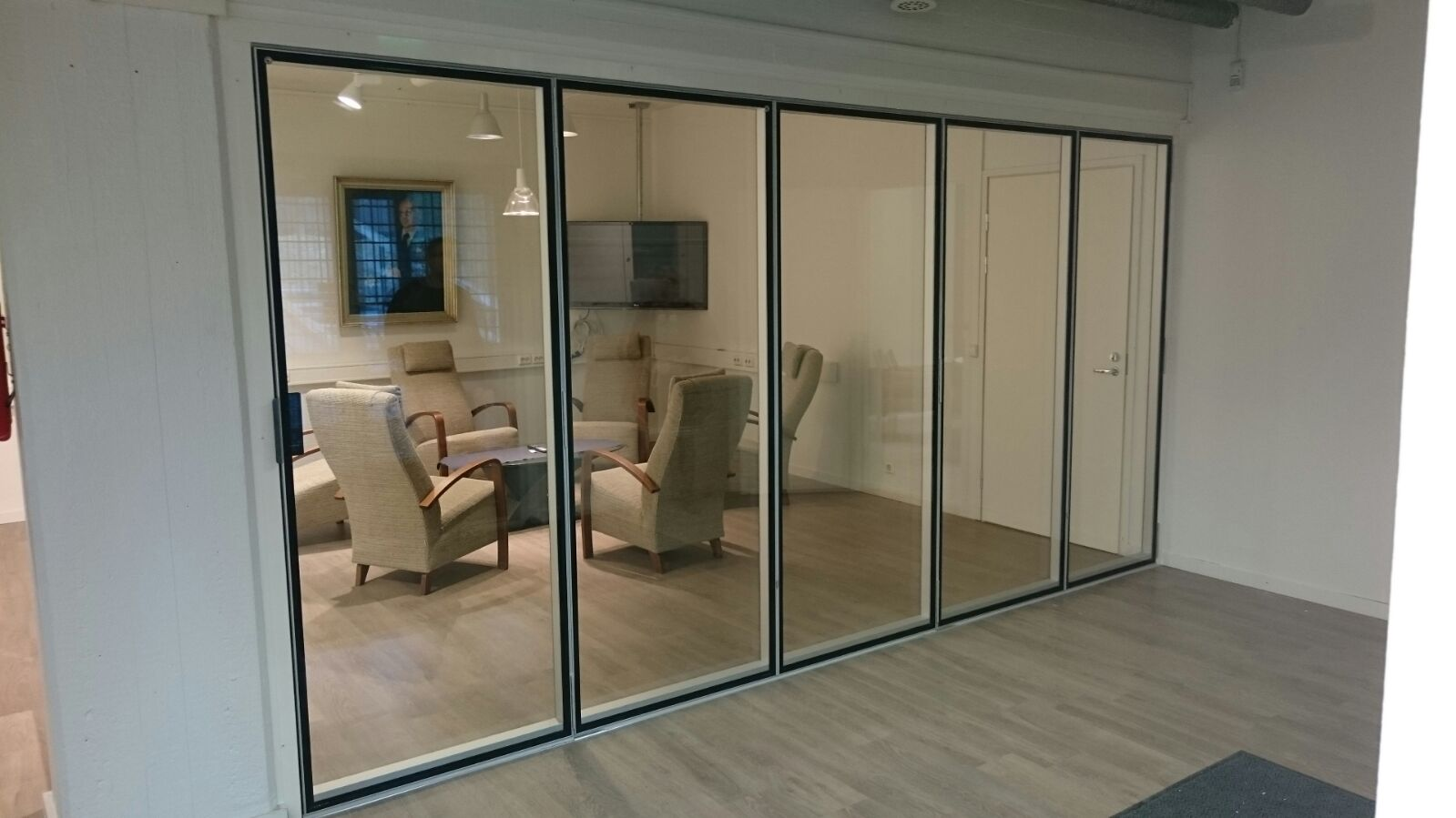 London wall launches new acoustic folding glass wall system for Folding glass walls