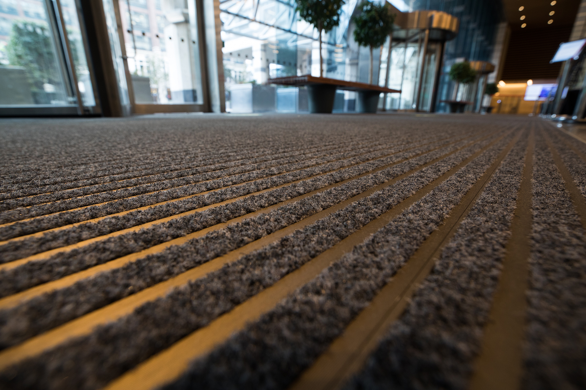 Bronze anodised entrance matting at Credit Suisse, One Cabot Square