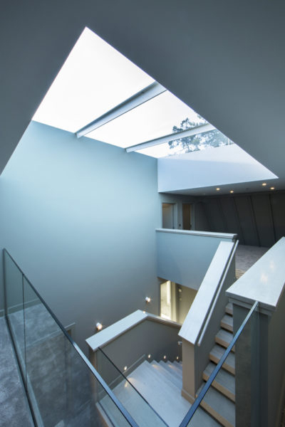Rooflights bring ventilation and access to coastal cottage