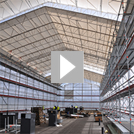 Video of the UBIX Temporary Roof installation using the RUNWAY method, where the roof is installed from a safe working platform and 'pushed' out.