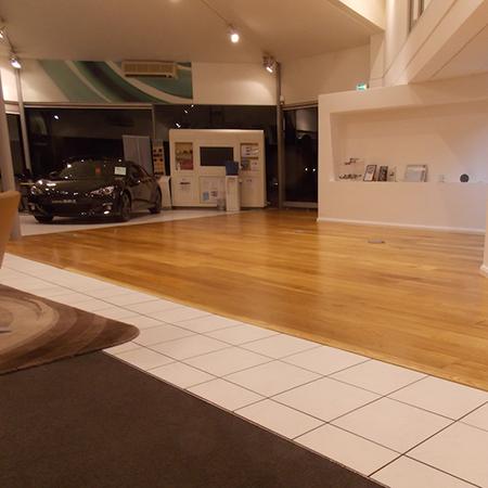Wood flooring in volvo showrooms for Hardwood floor showroom
