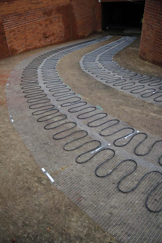 Bespoke heated mats for driveway heating efficiently deter ice & snow