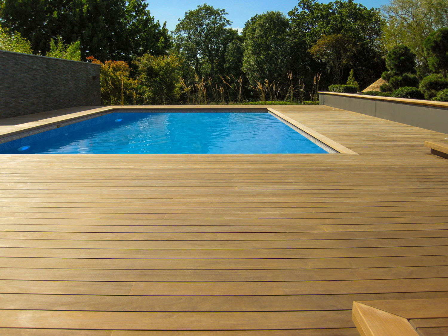 Ipe Timber Deck Boards surround pool at beautiful London residence