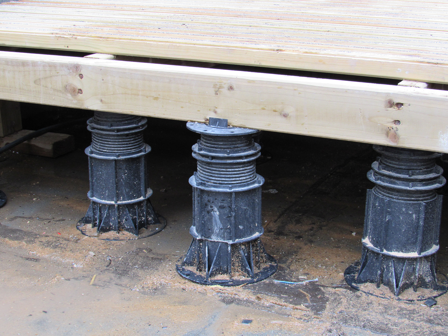 Pedestals for paving and timber decking. Adjustable pedestals and paving support pads