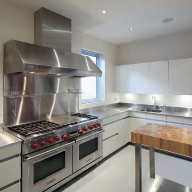 Stainless steel worktops installed at deluxe dwelling in Poole