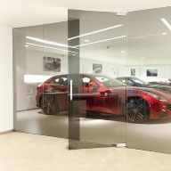 DORMA AGILE 150 sliding door system specified for Ferrari Showroom in Knightsbridge