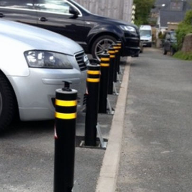 Manually retractable bollards for residential parking protection