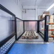 Low-rise platform goods lift for split-level storeroom