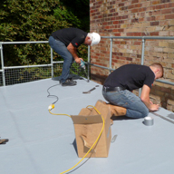 Reducing costs & risk on school roofing projects