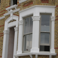 Cast stone architectural features to match adjacent properties