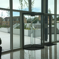 Minimalist full-glass revolving door for ISLAND tower