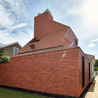 House wrapped in Marley Eternit roof tiles wins award