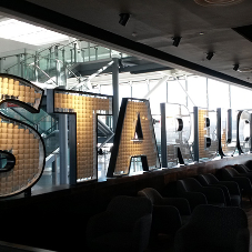Striking feature sign for Starbucks at Heathrow