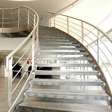 Spiral steel staircase for Farnborough Airport