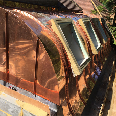 Surrey listed building gets copper roofs