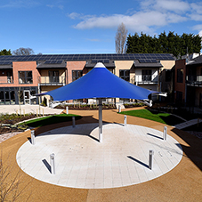 Tensile canopy for retirement complex