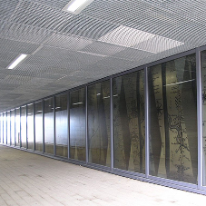 Steel grating used as ceiling panels for station