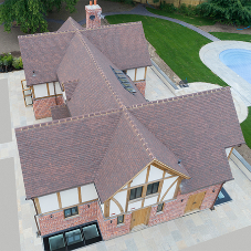 Handmade clay tiles create historic-style new build