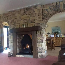 Cast sandstone wall cladding for fireplace