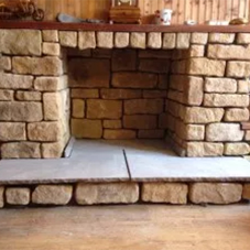 Cast stone cladding for fireplace