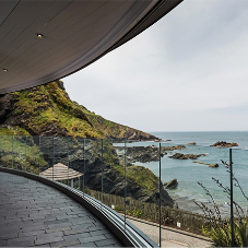 Elegant glass balustrade for coastal wedding venue