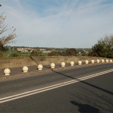 Recycled spherical bollards over The River Aire