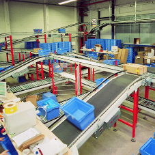Automated material flow system for warehouse