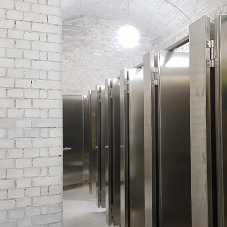 Brushed stainless steel cubicles at Royal Academy of Arts