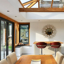 Oak orangery with modern bi-fold doors