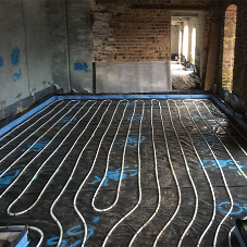 Underfloor heating and screed for 4 barn conversions