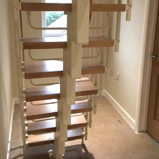 Compact loft conversion stairs for family home