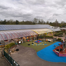 Covered playground extension in Church Langley