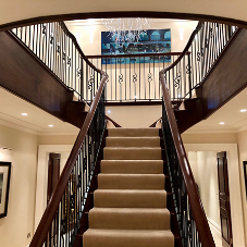 Bespoke mahogany and wrought iron staircase