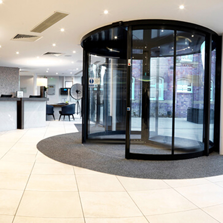 Revolving entrance for guests at elegant DoubleTree Hilton
