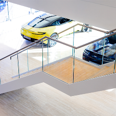 M&G chosen to install feature stair case for Aston Martin's showroom