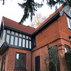 Mock Tudor property owner fits Guttercrest Moulded Ogee and Traditional Downpipe
