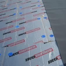 How many fixings are required to secure a flat roofing system?