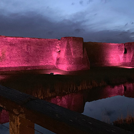 Powerful floodlights illuminate Caerphilly Castle
