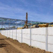 FP McCann's prestressed horizontal walling panels utilised on king post retaining wall