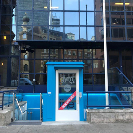Vibrant blue external to internal access lift for gym goers
