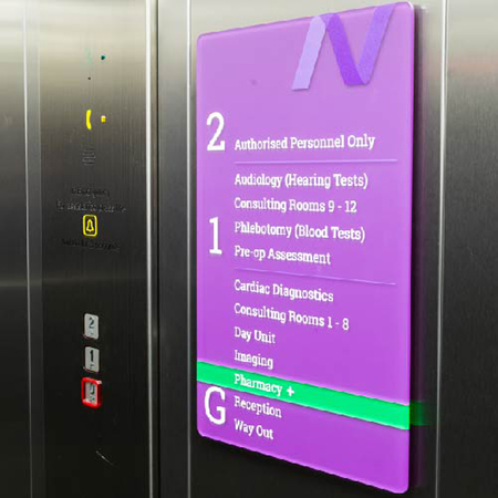 Vibrant purple internal signage for New Victoria Hospital