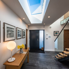 Frameless rooflights help accentuate this new builds open plan style