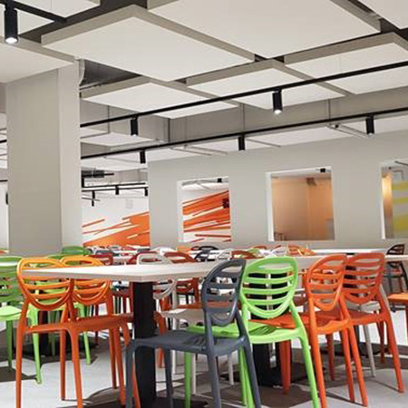 ACUSTIART absorbing panels create relaxing canteen area for workers and customers