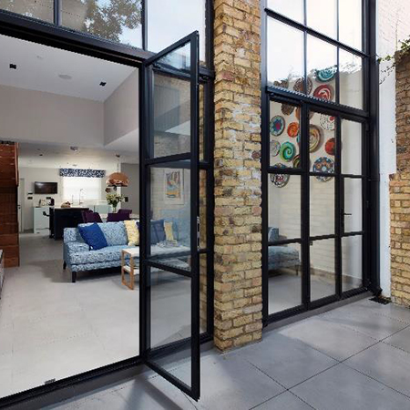Steel and glass frames extend beautiful rear extension
